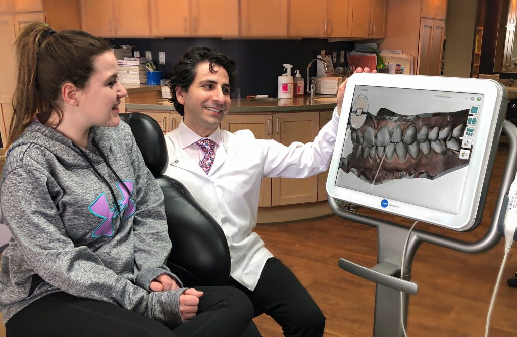 Dr. Berkman with a patient