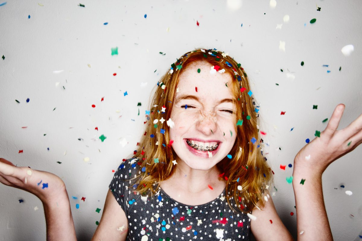 girl smiling with confetti