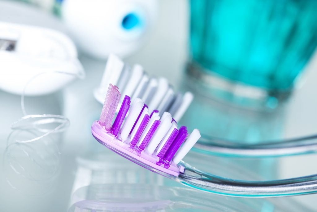 closeup up tooth brushes