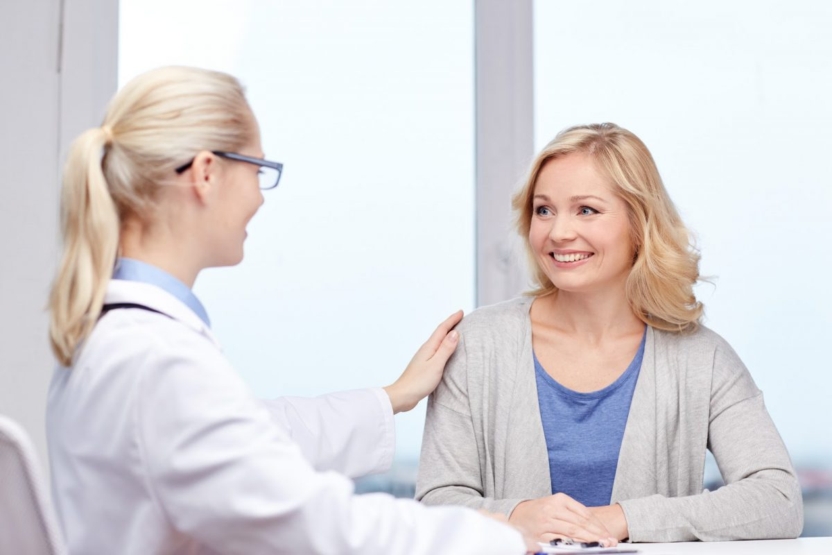 Adult Patient smiling while meeting with a doctor